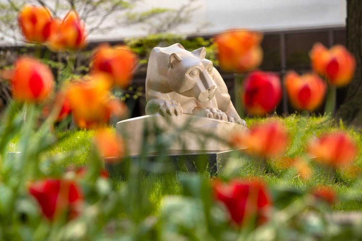 Image of lion statue with flowers