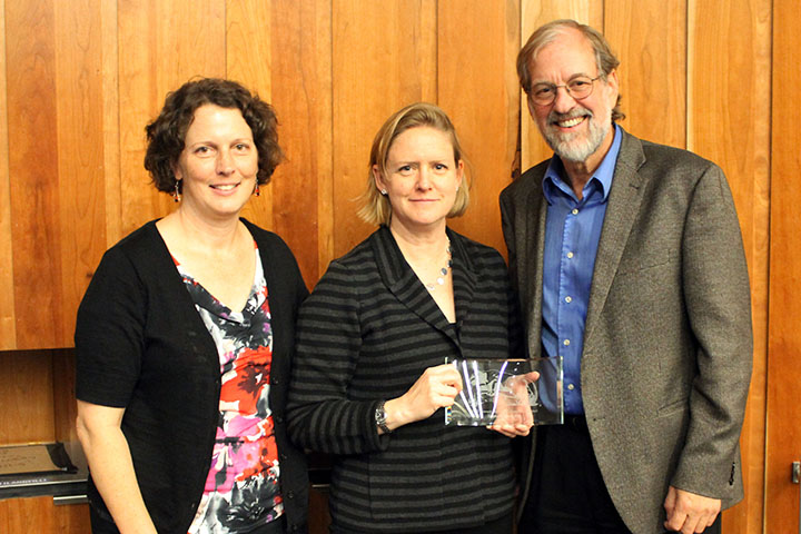 Edna Bennett Pierce Prevention Research Center Director Stephanie Lanza (left) and founding Center Director Mark Greenberg present Harvard Professor Stephanie Jones a gift of appreciation for presenting at the 2017 Bennett Lecture.