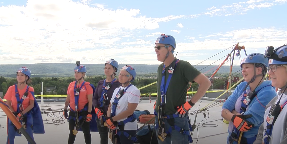 image of group preparing to rappel from building