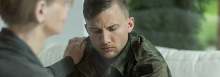 psychologist comforting soldier