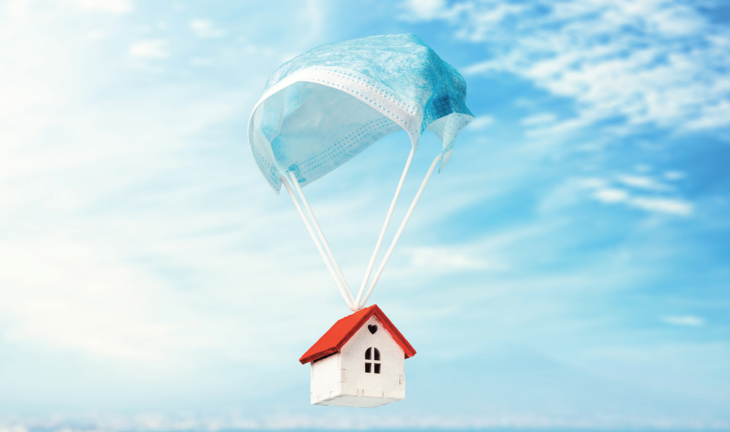 Image of house with a surgical mask acting as a parachute