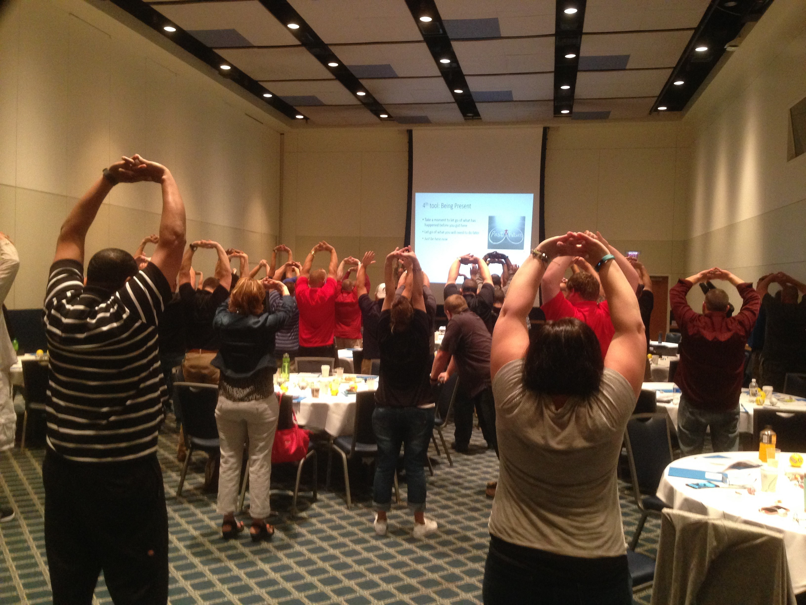 Pennsylvania's BJJS staff practice stress-reduction techniques during a recent session instructed by Penn State Research Associate Sebrina Doyle and consultant Mark Agrusti.