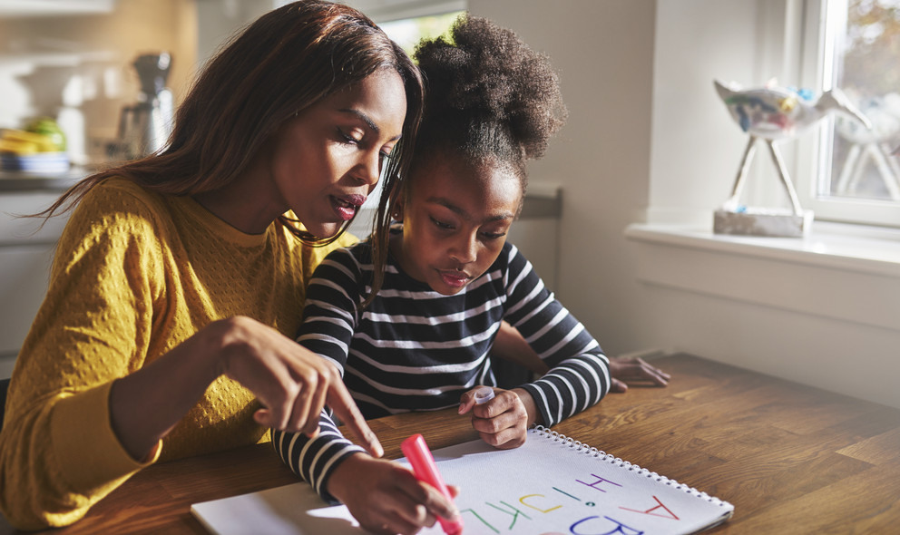 picture of mother helping child with homework