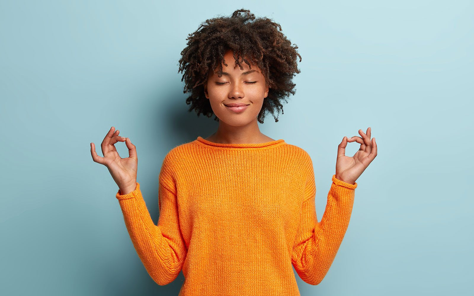 smiling teen in standing meditation pose
