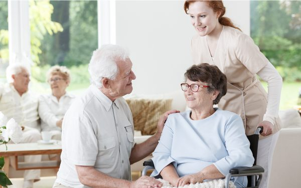 Elder man visiting his wife with Alzheimer's disease at the rest home